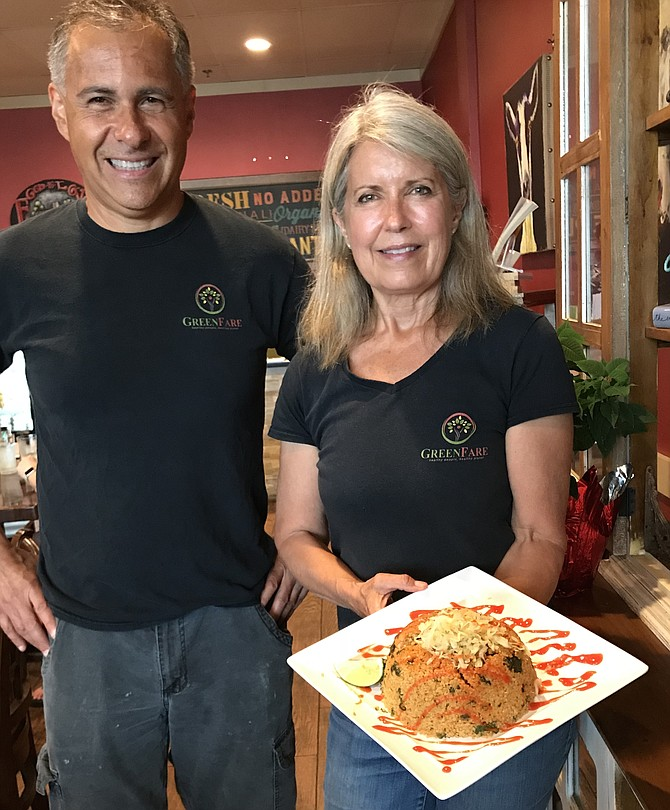 Pericles Silva, GreenFare operations manager, joins Gwyn L. Whittaker, CEO of GreenFare Organic Cafe in Herndon. The cafe is the first Platinum REAL Certified Restaurant in Virginia. It offers organic, whole plant food dishes, 7-day meal plans, books, classes and lectures.