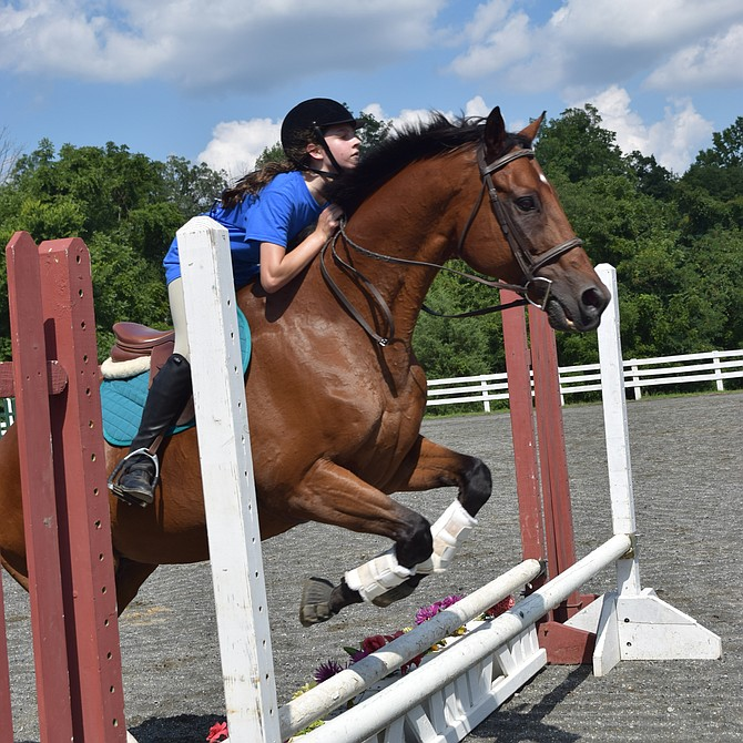 Helen Lyons, of the Hampton Horsefeathers 4-H Club, and her horse Chance take part in Show Jumping during the 2018 Fairfax County 70th Annual 4-H Fair and Carnival held at Frying Pan Park in Herndon.