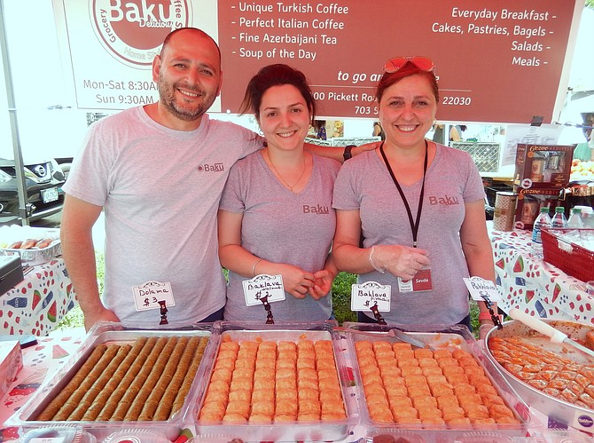 (From left) Co-owners of Baku Delicious, Namig and Natavan Bahadur, and Sevda Tahirli, general manager, offer a pistachio treat called dolama, plus walnut baklava, at their stand selling Azerbaijani, Turkish and Russian foods.
