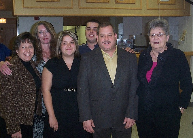 Dee Schmidt (at far right) with family members (from left) daughters Ellie Schmidt and Bridget Shepard, granddaughter Jessica Thornton, grandson Rick Schmidt Jr. and son Rick Schmidt.