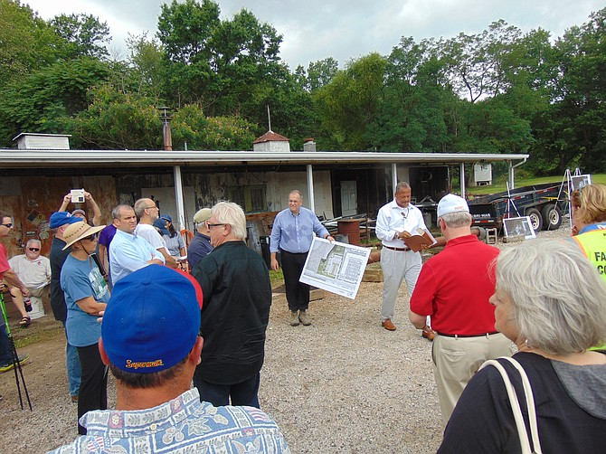 County officials and local residents tour the site at 8800 Richmond Highway on Wednesday, Aug. 1.