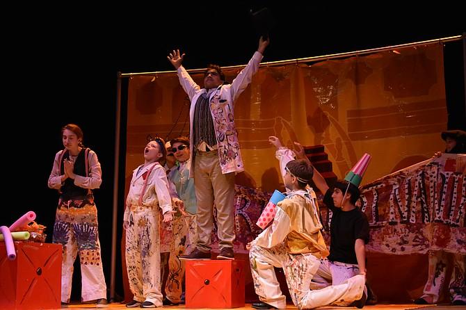 The Middle School Ensemble performed 'The Bourgeois Gentleman' on Friday. Jeebu Foraida (center) played Monsieur Jourdain.