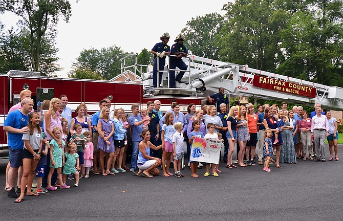 Residents of the Timberly neighborhood in McLean gathered to express their thanks to law enforcement and public safety personnel during the neighborhood's National Night Out celebration.