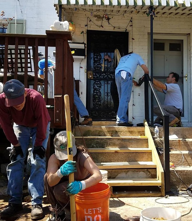 Dwaine and other volunteers at Mrs. P's home on National Rebuilding Day in April.