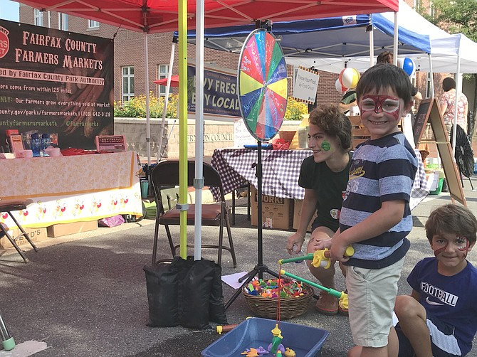 On Thursday, Aug. 9, during National Farmers Market Week, Emmet Drost, 7, from Herndon and his brother Sawyer, 5, try their skills at 'local fishing' during the Fairfax County Park Authority Farmers Market in Historic Downtown Herndon.
