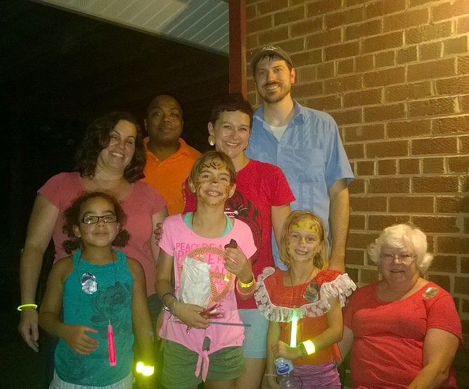 The spirit of this year's National Night Out block party is captured on the front porch of Bren Mar resident Sue Hotto, seated far right.  Back row:  Lisa Wesley, her husband, Bey Wesley, Bonnie Robinson and her husband, Lenny Bankester.  Front row:  Eva Wesley, Sylvie Bankester, Melody Bankester and Hotto.