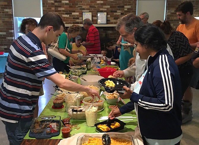 Greenbriar residents enjoy a potluck meal during their celebration.