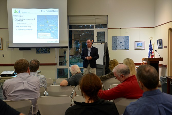 Robert Bell, Sewer Program Manager with DC Water, details the Potomac Interceptor pipeline system to interested residents at the Great Falls Library. The meeting is one in a long series of gatherings between the company and the community to discuss rehabilitation of the system.