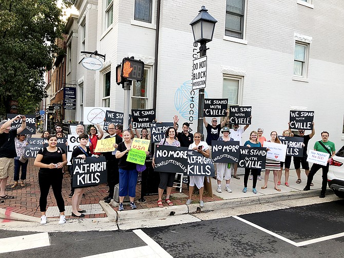 Protestors with Grassroots Alexandria and Christ Episcopal Church outside the former home of white nationalist Richard Spencer in Old Town. The group protested outside the second floor residence twice a month for a year-and-a-half.