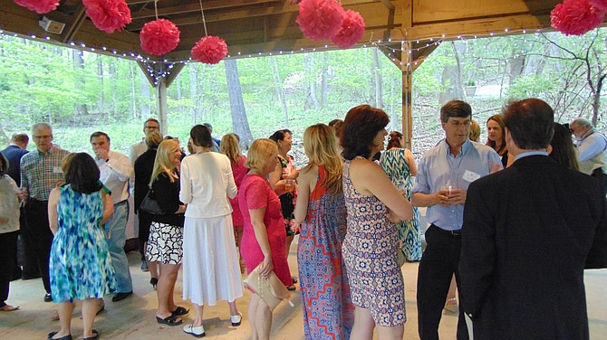 Guests mingle at the New Dominion Women's Club party.