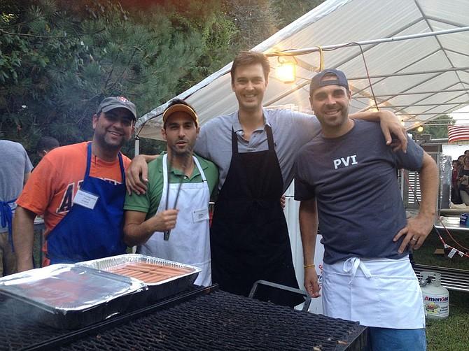 Manning the grill last year at Holy Transfiguration's Middle Eastern Food Festival are, from left:  Robert Salem, Omar Samaha, Marks Brubaker and Matt Leiva.