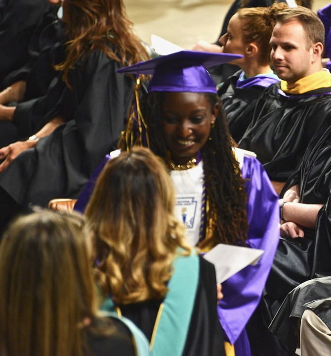 Top-rated high schools: One of the shining stars from Lake Braddock Secondary School's 2018 graduating class, Sinclaire Jones accepts her diploma. Her proud family reports that Sinclaire is heading to Princeton, where she will study to be an astrophysicist.