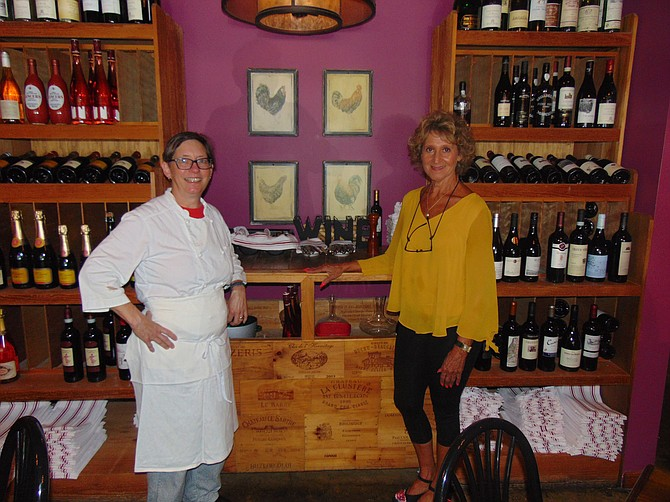 Chef-owner Caroline Ross with bartender Kathy Coombs in the dining room of the River Bend Bistro & Wine Bar.