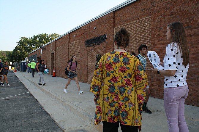 West Springfield teachers monitor as students file in on the first day of school.