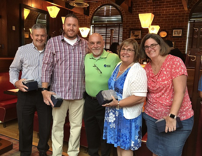 WiSC Enterprises founder and president Bill Craig, center, poses with some of his employees Aug. 21 at the 10th anniversary celebration of the founding of the company. The Chantilly-based company was recently named the recipient of the 2018 Public Sector Pro Patria Award, the highest award given to a civilian employer by the Virginia Employer Support of the Guard and Reserve Committee. With Craig at Mike's American Grill are: Greg Creech, Mark Mogle, Betty Musa and Cary McConnell.