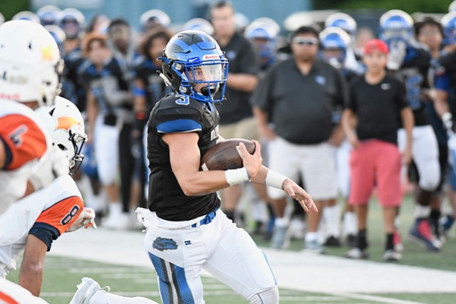 West Potomac quarterback JT Mayo passed for 263 yards and a touchdown and rushed for 109 yards and another touchdown against Briar Woods on Aug. 24.
