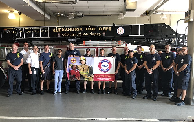 Alexandria Fire Chief Robert Dube, third from left, joins firefighters and paramedics Aug. 28 at Station 209 in Potomac Yard to kick off the annual Fill the Boot campaign to raise funds for the Muscular Dystrophy Association.