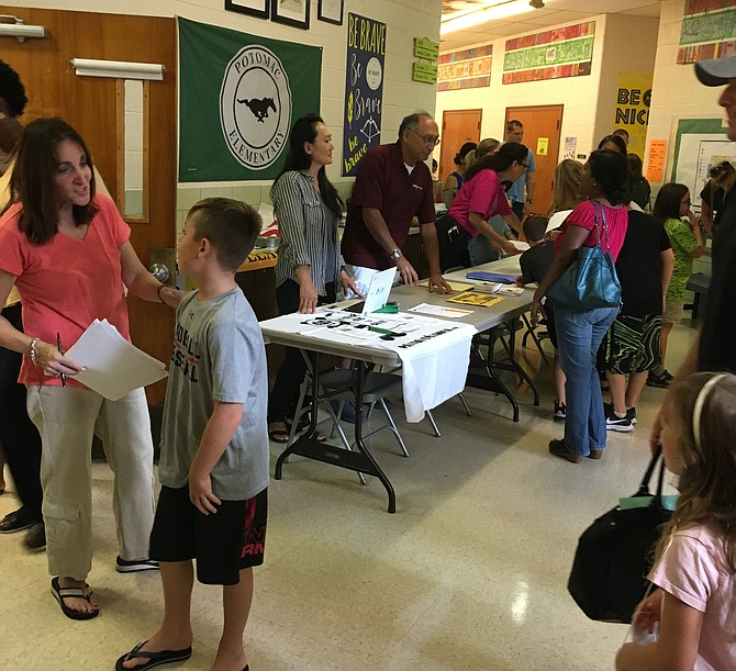 Faculty and Staff of Potomac Elementary School greet students and parents at the school's Open House. Potomac Elementary will be housed at the old Radnor Elementary School in Bethesda during the construction of a new school in Potomac.