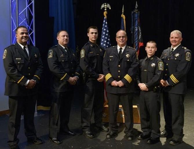 From left, Lieutenant Tu Farhan, Lieutenant Thomas Taylor, Officer Ryan Colligan, Chief James Morris, Officer John Nesbitt, and Major Daniel Janickey.