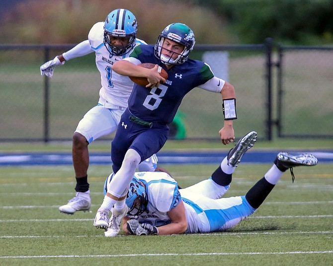South County QB Matthew Dzierski #8 avoids being brought down by Centreville's Joey Purvis #52.