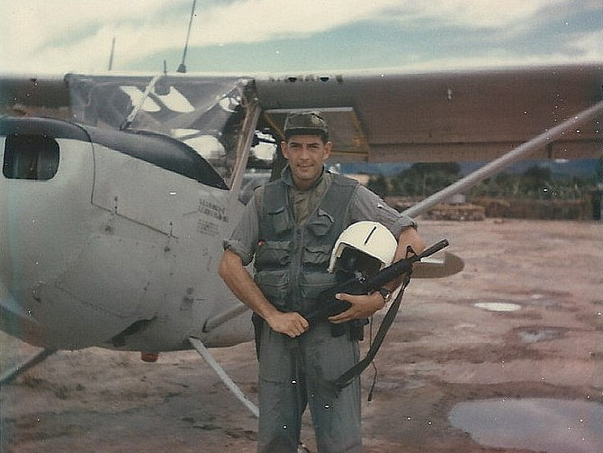 Walt Potock by his USAF O-1 Bird Dog aircraft in 1967-68 Vietnam.