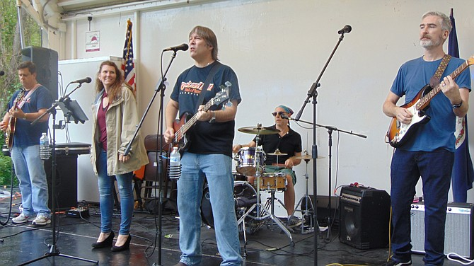 The Delaney Hall Band performs.
