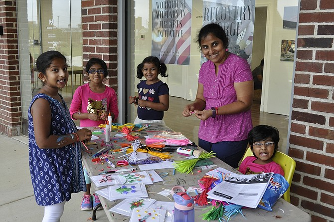 Children do a crafts project during the 10th Anniversary of the Workhouse Arts Center last weekend.