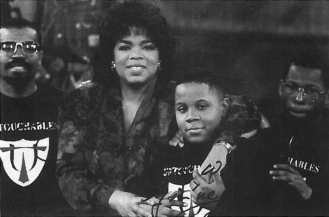 Oprah Winfrey with Ronnie Haskins, one of three young boys who sparked the idea behind the Untouchables mentoring program, which was honored by Winfrey in 1991. Haskins is now studying for his doctorate.