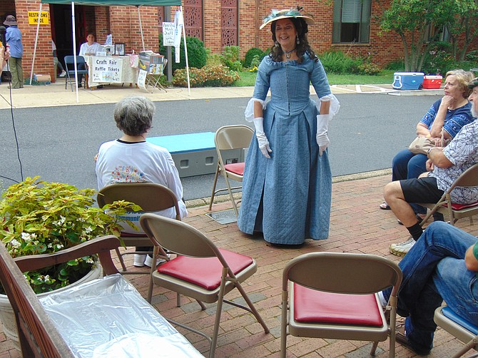 Nancy Mason, oldest of nine children of Virginia statesman George Mason and portrayed by retired history teacher Janis Harless, speaks to those attending the St. Luke's Craft and Family Fun Fair on Saturday, Sept. 8.
