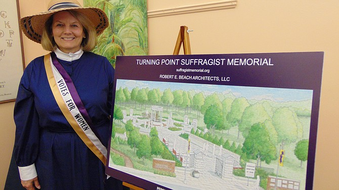 Patricia Depew Wirth, executive director of the Turning Point Suffragist Memorial Association, shows plans for the memorial.