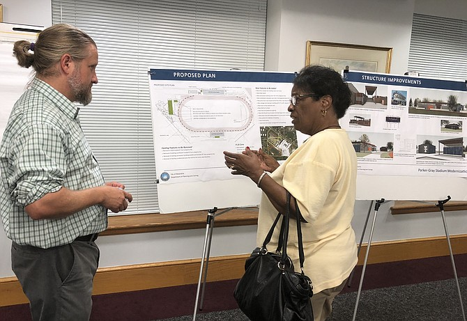 Seminary Civic Association president Frances Terrell, right, questions principal city planner Nathan Imm about the proposed plans to renovate Parker-Gray Memorial Stadium at T.C. Williams High School at the project's Sept. 5 open house at City House. The plans include the addition of lights to allow for night time games and events.