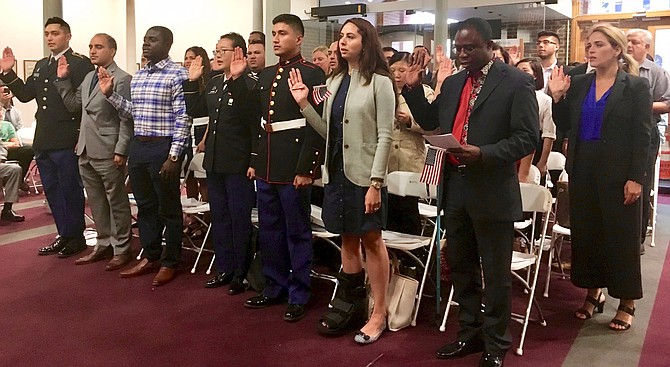 Thirty-five people from 25 countries became U.S. citizens at a naturalization ceremony held Tuesday, Sept. 11 at city hall.