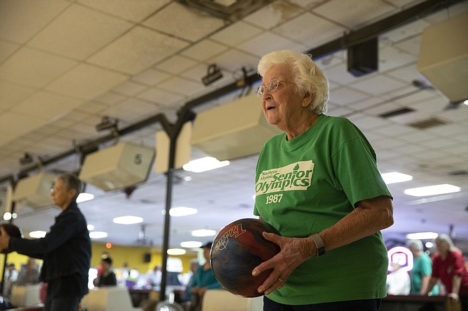 Ninety-three-year-old Marge McNare from Fairfax prepares to bowl in game one of the 2018 Northern Virginia Senior Olympics at Bowl America Shirley in Alexandria on Sept. 17.  McNare enjoys bowling twice a week in a Falls Church league.