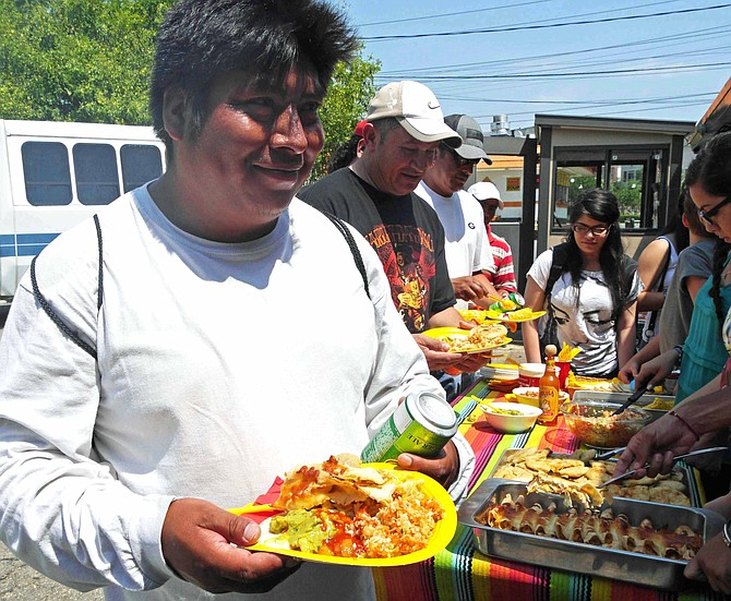 SEEC workers are served lunch by local church youth while waiting for potential temporary employment.