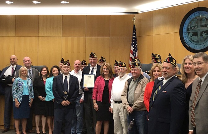 Members of the Wayne M. Kidwell American Legion Post 184 accept the Town of Herndon Proclamation recognizing POW/MIA Day Friday, Sept. 21, 2018, from the Mayor and Town Council of Herndon.
