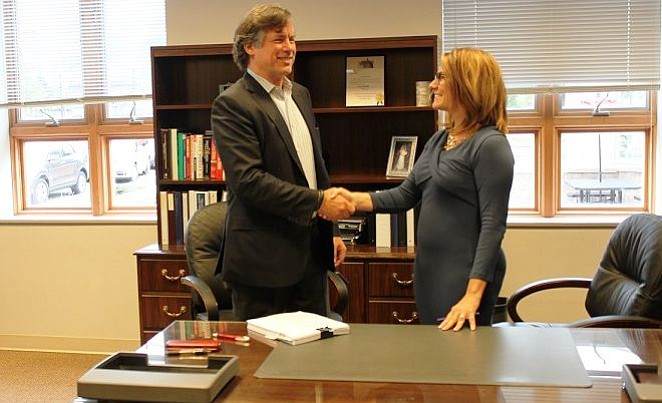 In the fall of 2017, Larry Bergner, Comstock Senior Vice President of Development shakes the hand of Town of Herndon Mayor Lisa C. Merkel.   Comstock Venture LC and the Town of Herndon moved forward with a signed Comprehensive Agreement, which defined responsibilities of both parties in the redevelopment of 4.675 acres of town-owned land in Herndon's downtown into a mixed-use project.