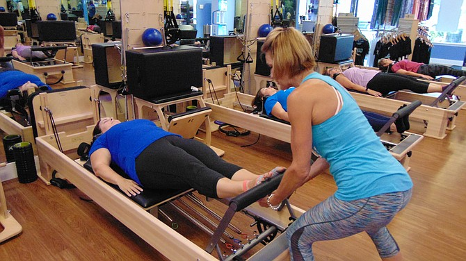 Lead Pilates instructor Rebecca Ceccin teaches footwork on the Reformer.