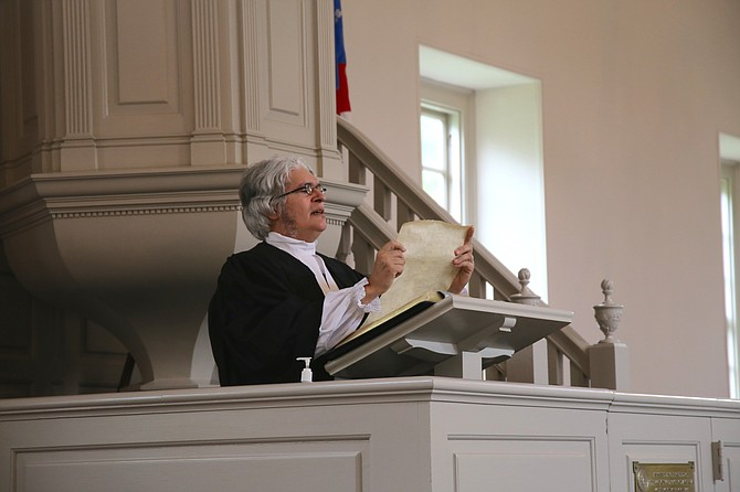 The Rev. Thomas Costa, in colonial minister attire, reads the preamble to the Constitution from the Pohick pulpit.