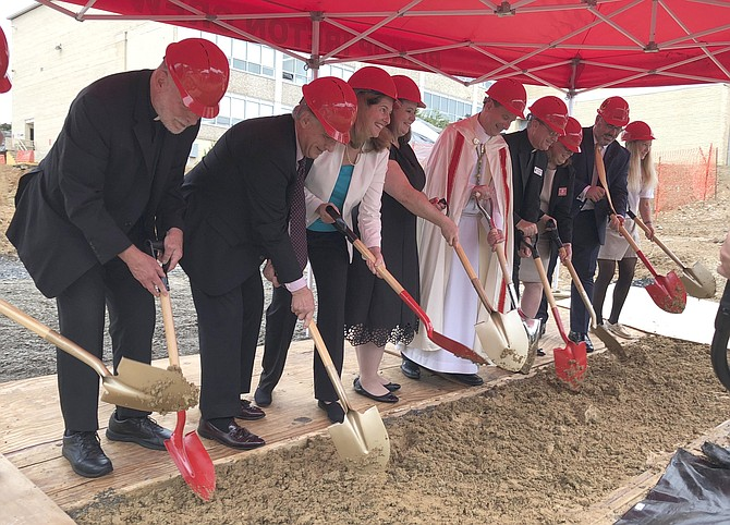 Bishop Michael Burbidge, center, leads local and school dignitaries in breaking ground Sept. 18 for the new 40,000-square-foot academic center at Bishop Ireton High School.