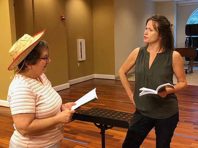 "Shayne Gardner and Elizabeth LeBoo in rehearsal for ""A Tuna Christmas"" presented by the McLean Community Players."