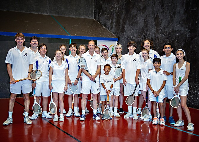 His Royal Highness Prince Edward [center] stands with the young Prince's Court Tennis players from McLean Sport & Health Club. Court Tennis is the original racquet sport from which the modern game of tennis is derived.