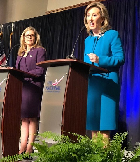 U.S. Rep. Barbara Comstock (R-10) responds to questions from Loudoun County Chamber of Commerce panelists during a 90-minute debate Sept. 21 at the National Conference Center in Leesburg, while her challenger, state Sen. Jennifer Wexton (D-33) looks on.