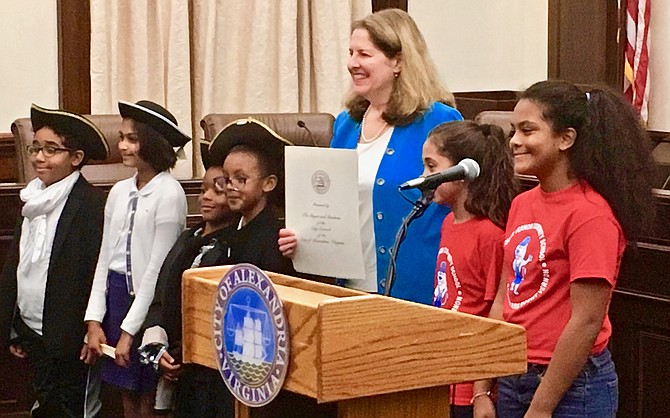 Mayor Allison Silberberg and ACPS students show off a local proclamation commemorating the 231st anniversary of the U.S. Constitution's signing.