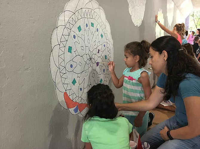 "Lake Anne Elementary students, their families, teachers and the community came together to create the tunnel mural ""Community Circles,"" based on mandala designed by the students."