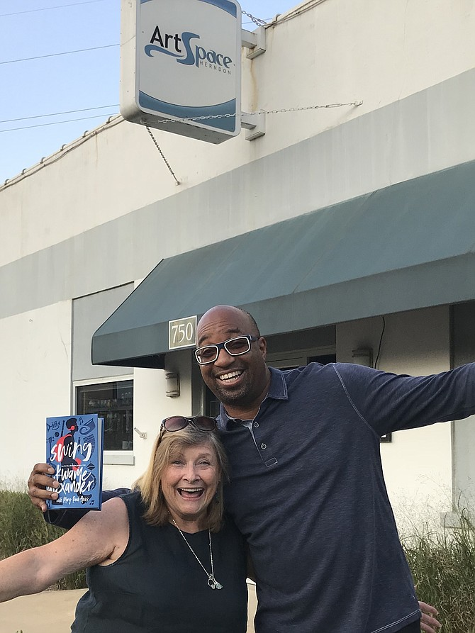 "Newbery Medalist and Herndon resident, Kwame Alexander, author of the New York Times Bestseller, ""Rebound,"" holds a copy of his and Mary Rand Hess' new book, ""Swing"" after he and Jo Ormesher, CEO and President of Arts Herndon prepared for Arts Herndon's inaugural ""Children's Literary Festival.""  The event will be on Sunday, Oct. 7, 2018, 11 a.m. to 4 p.m. at ArtSpace Herndon, 750 Center Street in Historic Downtown Herndon."