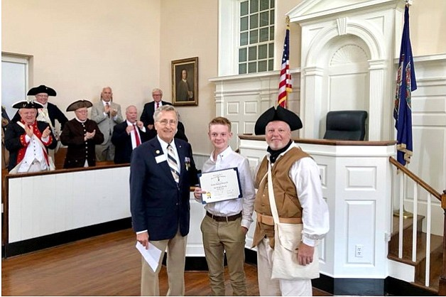 From left: Mike Weyler, Jacob Michael Duncan and Leamon Duncan. In background: Fairfax Resolves interpreters are giving Jacob a hand after his induction into the Virginia Society, Sons of the American Revolution at the historic Fairfax Courthouse.