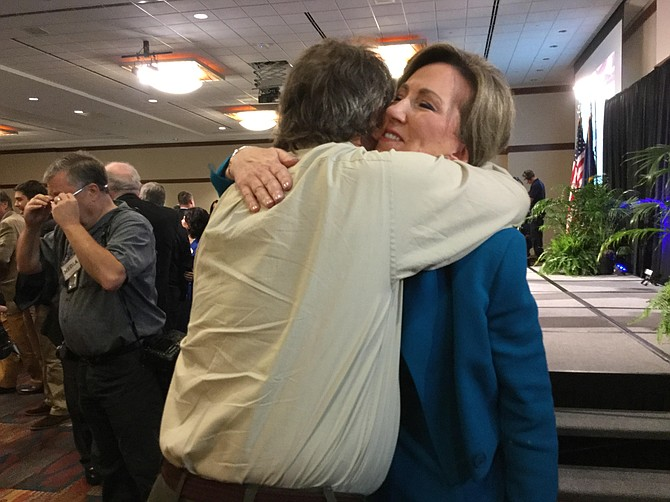U.S. Rep. Barbara Comstock (R) embraces a longtime friend after the first debate with Democratic challenger Jennifer Wexton on Sept. 21 in Leesburg.