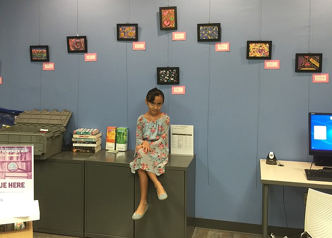 "Noura Barka's exhibit ""Kiss the Dream and Smile"" is at the  Connection Crystal City Satellite Library at 2117 Crystal Plaza Arcade, Arlington."