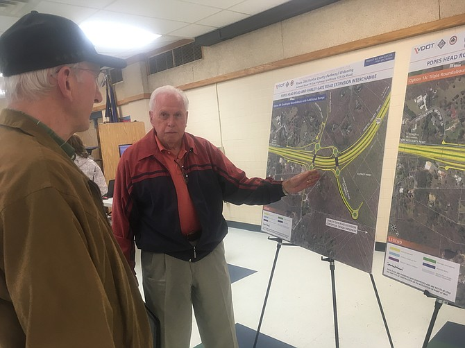 At the meeting, Larry Hoss has some ideas about the design.