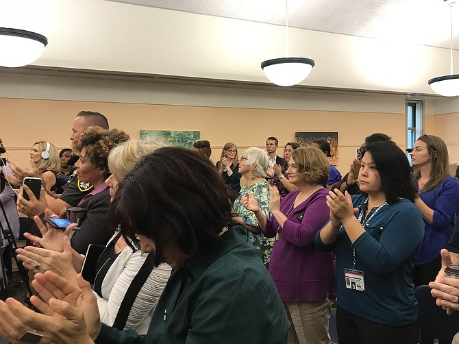 "Attendees at the ""Make the Call"" panel presentation in recognition of Domestic Violence Awareness Month 2018 applaud Del. Kathleen Murphy (D-34) after she announces publicly for the first time: ""I am a survivor. I was a victim of sexual assault in college. … I believe when we stand together, side by side ... and we can say it, out loud, 'We are victims of abuse' ... we demonstrate we can move forward and win."""